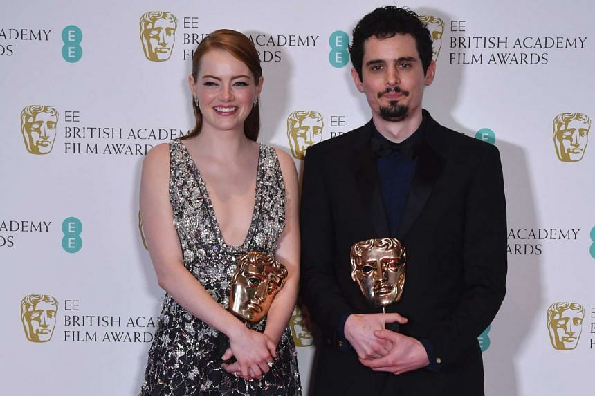 Actress Emma Stone and director Damien Chazelle pose with the awards for Best Leading Actress and Best Director, respectively, for the film La La Land at the British Film Awards at the Royal Albert Hall on Feb 12, 2017.