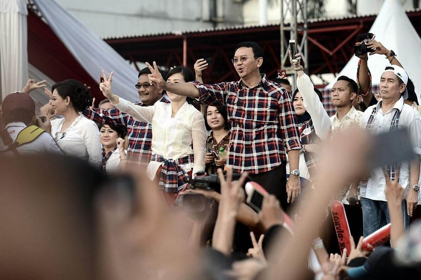 Jakarta governor Basuki Tjahaja Purnama, popularly known as Ahok, gesturing to his supporters at his final campaign rally prior to the gubernatorial election in Jakarta on Feb 11, 2017.