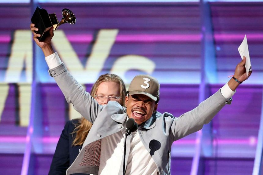 Chance the Rapper celebrates as he accepts the Grammy for Best Rap Album for Coloring Book at the 59th Annual Grammy Awards in Los Angeles, on Feb 12, 2017.