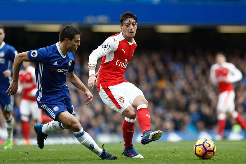 Arsenal midfielder Mesut Ozil (centre) passing the ball against Chelsea during the EPL match on Feb 4, 2017.