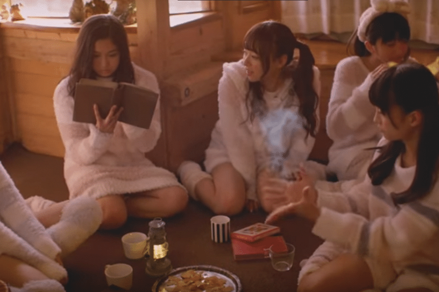 The members of Japanese girl group Magical Punchline play schoolgirls at a magic school.