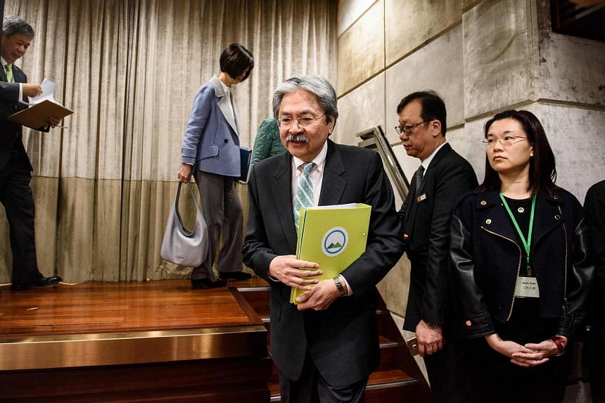 Former financial secretary John Tsang (centre) arriving at a press conference held to announce his election platform in Hong Kong, on Feb 6, 2017.