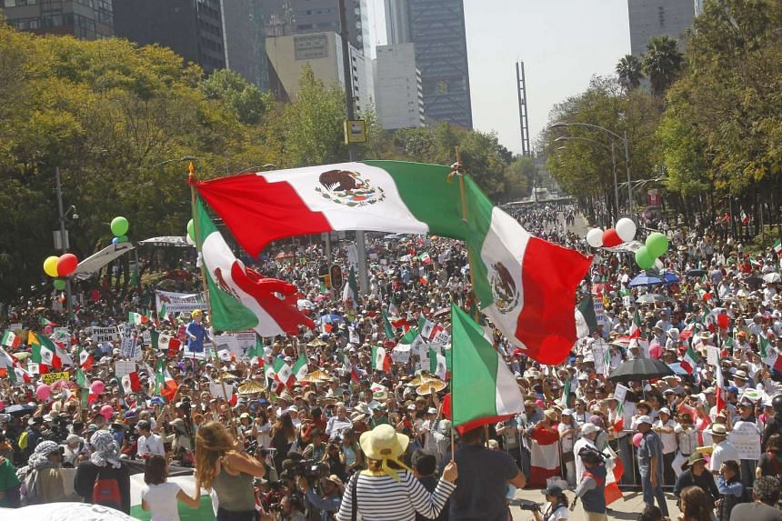 Mexicans demonstrating during a protest against US President Donald Trump in Mexico City on Feb 12, 2017.
