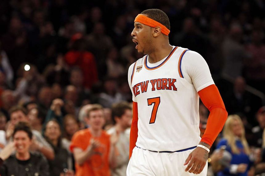New York Knicks forward Carmelo Anthony (#7) reacting after scoring against the San Antonio Spurs during their NBA match on Feb 12, 2017.