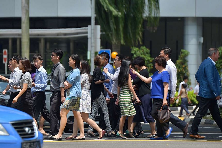 Office workers at Singapore's Central Business District. An annual government survey has revealed that cost of living and job security are among the top concerns of Singaporeans ahead of Budget 2017.