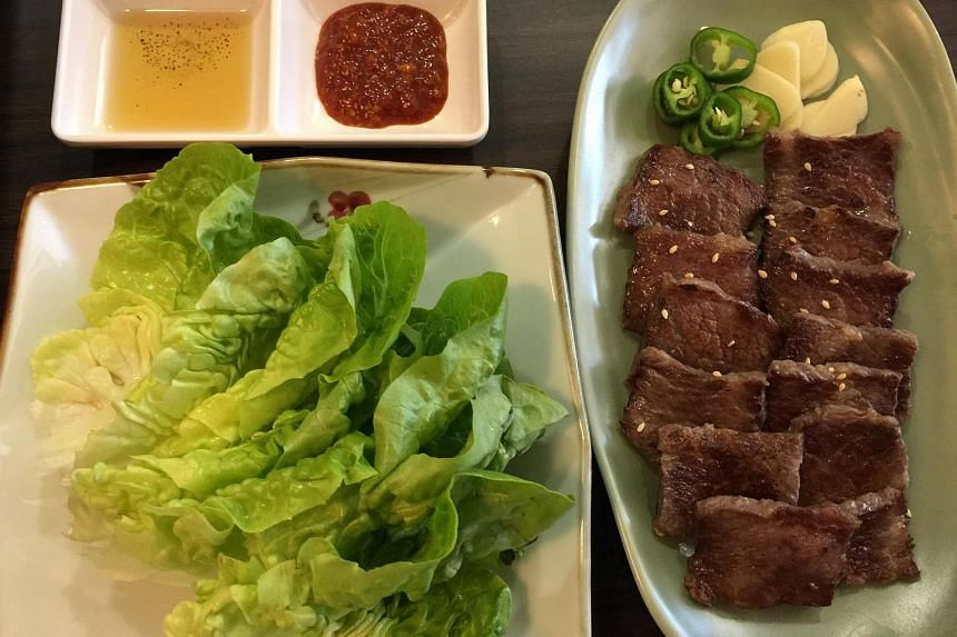 Gal Bi Sal (S$38) is surprisingly good, grilled, boneless US beef short ribs, cut into bite-size squares and served already grilled with lettuce, sliced green chillis and raw garlic.