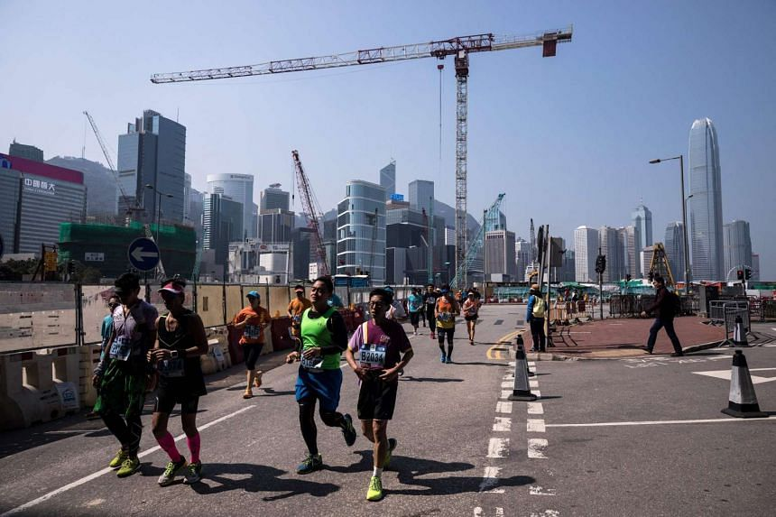 Runners take part in the Hong Kong Marathon, on Feb 12, 2017.