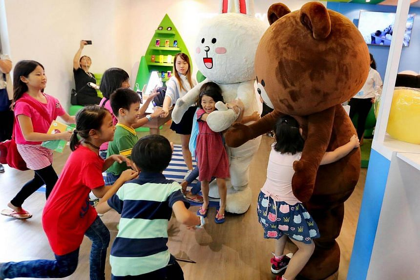 Students from low-income families rushing to hug the Line mascots at the Samsung experiential theme zone at the Westgate mall on Feb 11, 2017.