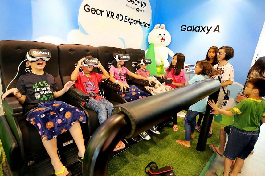 Students from low-income families experiencing the Gear VR 4D at Samsung theme zone at the Westgate mall on Feb 11, 2017.