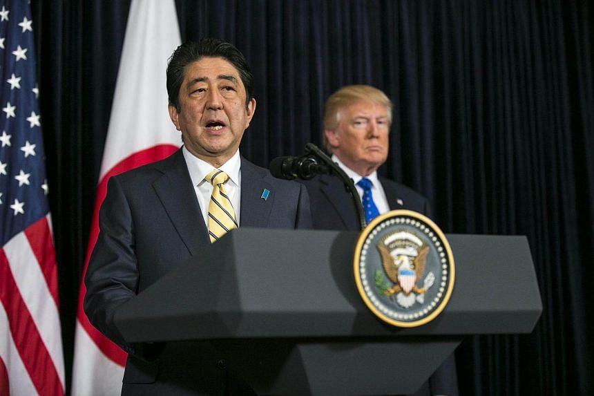 """Japanese Premier Shinzo Abe (left) called the launch """"absolutely intolerable"""", while US President Donald Trump said the US """"stands behind Japan, its great ally, 100 per cent""""."""