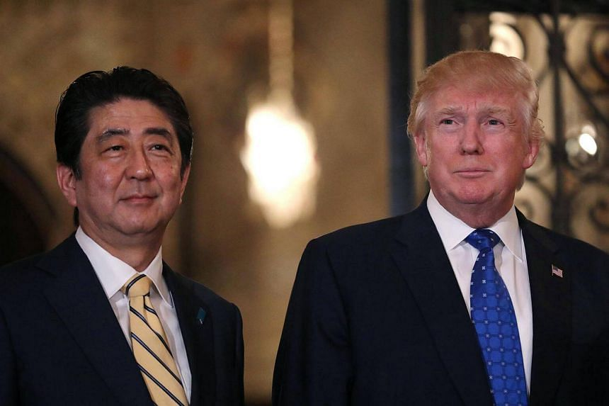 Japanese Prime Minister Shinzo Abe and US President Donald Trump posing for a photograph before attending dinner at Mar-a-Lago Club in Palm Beach, Florida, US, on Feb 11, 2017.