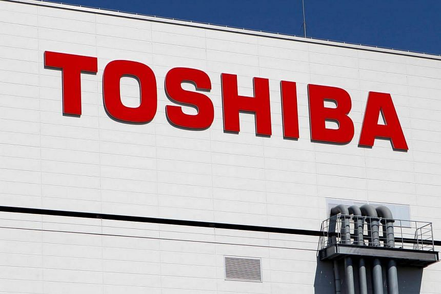 The logo of Toshiba is pictured on its factory, in Yokkaichi, western Japan on Sept 9, 2014.