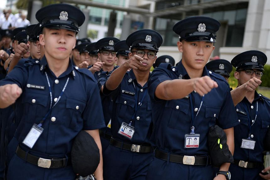 File photo of police trainees marching out of the parade square at the Home Team Academy. Officers from the police, Singapore Civil Defence Force and other agencies will march alongside one another at the Home Team's inaugural gala show in May.