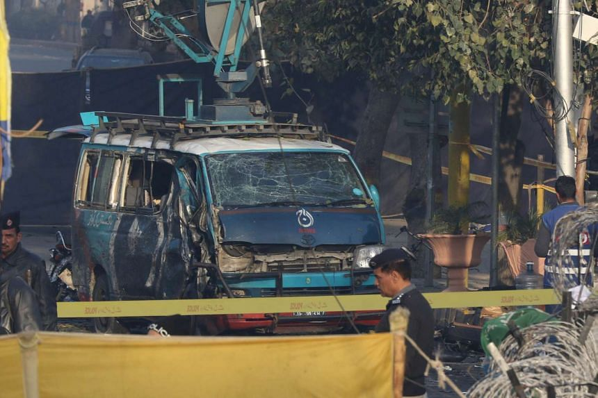 Security officers inspecting the scene of a suicide bombing in Lahore on Feb 14, 2017.
