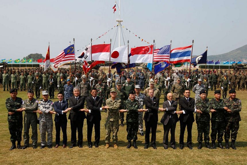 US Admiral Harry Harris and Thai Chief of Defence Forces Surapong Suwana-Adth (centre) posing for a picture with other commanders during the opening ceremony for Exercise Cobra Gold in Chonburi, Thailand, on Feb 14, 2017.