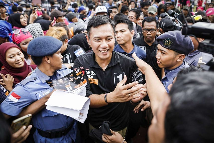 Agus Yudhoyono (centre greets the crowd at a campaign rally in Jakarta, Indonesia, Feb 11, 2017.
