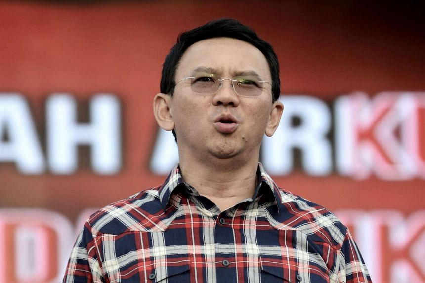 Jakarta's governor Basuki Tjahaja Purnama singing the Indonesian national anthem during his final campaign rally, on Feb 11, 2017.