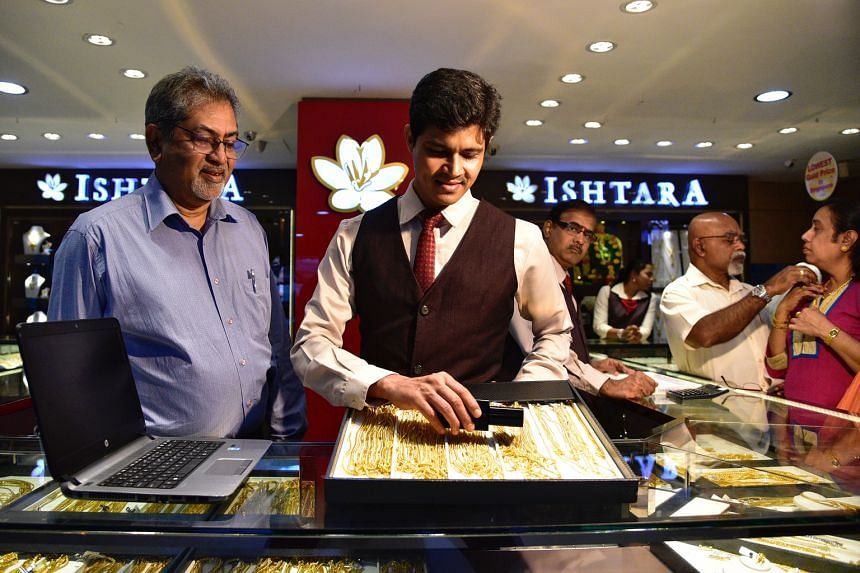 Ishtara Jewellery's director Suresh Keerthi (left) and sales manager Vijayananthraj. The gold retailer is one of thousands of companies responding to the call to raise productivity. Across sectors, firms have poured resources into automation, worke