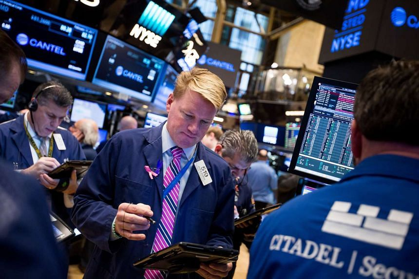 Traders work on the floor of the New York Stock Exchange in New York, US on Feb 13, 2017.