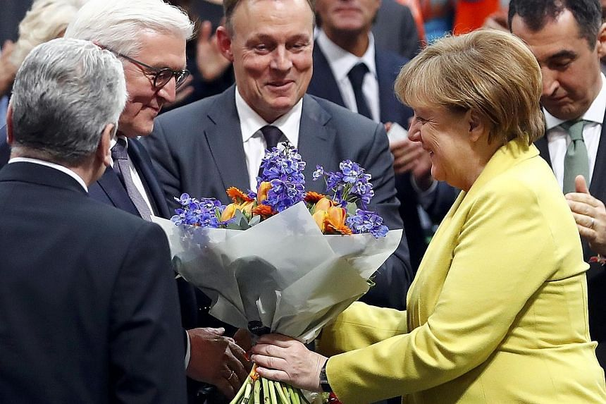 """Dr Merkel congratulating Mr Steinmeier on his election as Germany's president on Sunday. Instead of """"eliminating"""" one rival in her bid for re-election, the Chancellor may have """"created"""" another contender for the country's top post."""