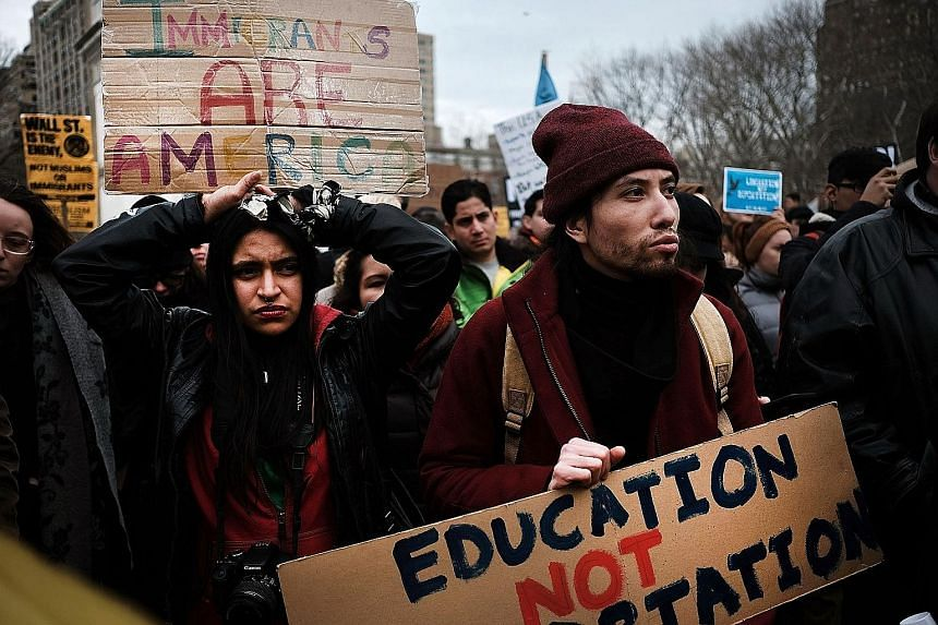Protesters at a demonstration against the immigration policies of US President Donald Trump in Washington Square Park in New York City on Saturday. His travel ban, despite being blocked by the courts, has given terror group ISIS ammunition to weaponi