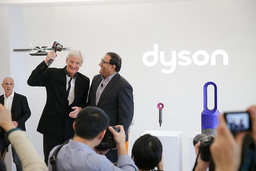 Mr Iswaran and Mr Dyson at the launch of Dyson's new technology centre in Science Park yesterday. Its research areas include artificial intelligence, robotics and software development.