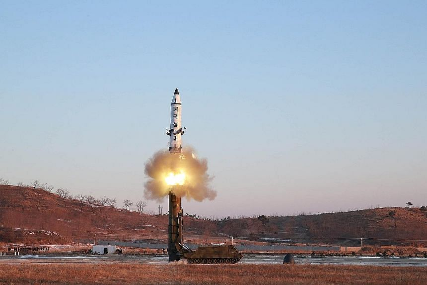 The Pukguksong-2 missile being launched, in an undated photo released by North Korea's Korean Central News Agency in Pyongyang yesterday. North Korea claims the missile can carry a nuclear warhead.