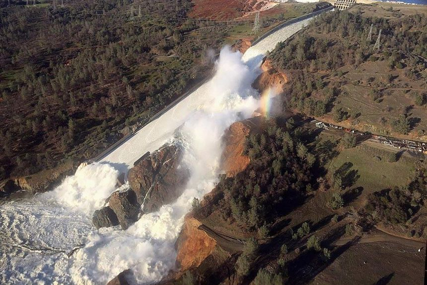 The damaged spillway with eroded hillside in the Oroville Dam area in California. Crews using helicopters prepared to drop rocks to seal the spillway, and the authorities were releasing water to lower the lake's level after weeks of heavy rain in the