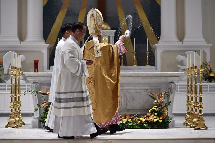 Archbishop William Goh consecrating the altar at the Cathedral of the Good Shepherd during the dedication ceremony, on Feb 14, 2017.