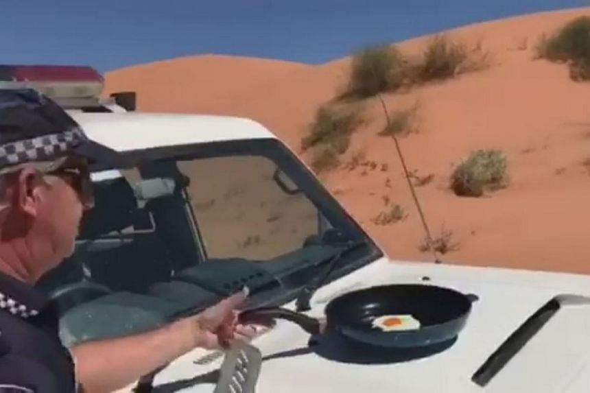 An Australian police officer from the town of Birdsville cooking an egg on the bonnet of his car during a heatwave.