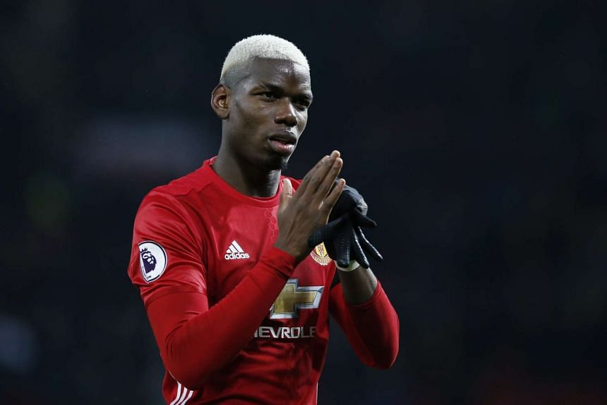 Manchester United's Paul Pogba applauding the crowd after the EPL match against Watford on Feb 11, 2017.