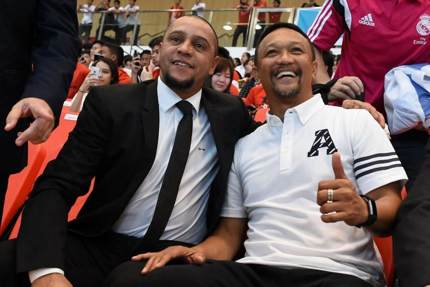 Fandi Ahmad (right) poses with Brazilian football legend Roberto Carlos during their meeting with students in Singapore on February 13, 2017. In a storied career filled with championships and accolades, there is one title that Fandi craves - the SEA