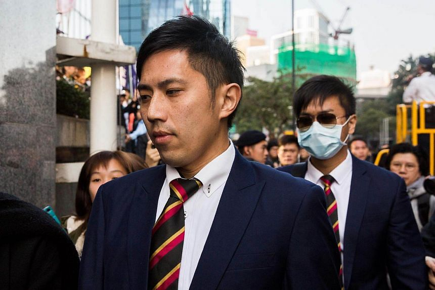 Detective police constable Kwan Ka-ho (front), one of seven police officers who allegedly beat activist Ken Tsang during the 2014 pro-democracy protests, arrives at the District Court in Hong Kong.