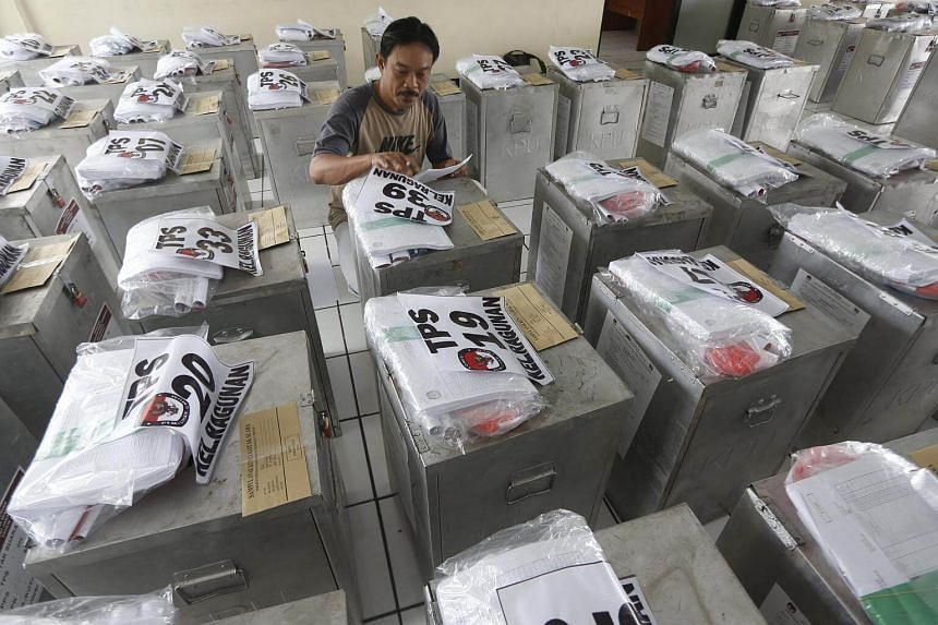 An election worker checking ballot boxes before they are distributed to voting booths in Jakarta, Indonesia, on Feb 13, 2017.