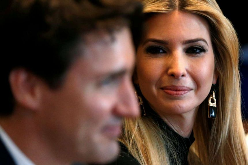 Ivanka Trump looks at Canadian Prime Minister Justin Trudeau (left) during a roundtable discussion at the White House on Monday (Feb 13, 2017).