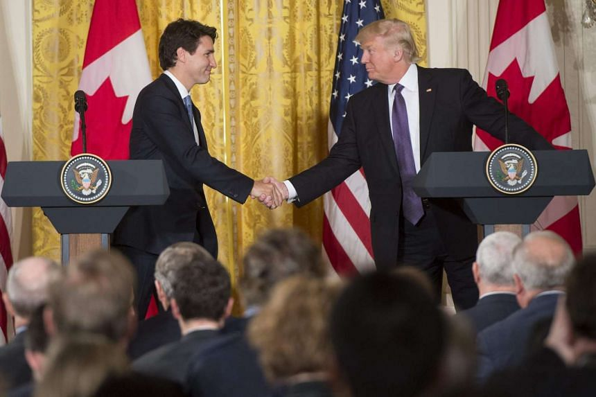 US President Donald Trump and Canadian Prime Minister Justin Trudeau shake hands during a press conference at  the White House on Monday (Feb 13, 2017).