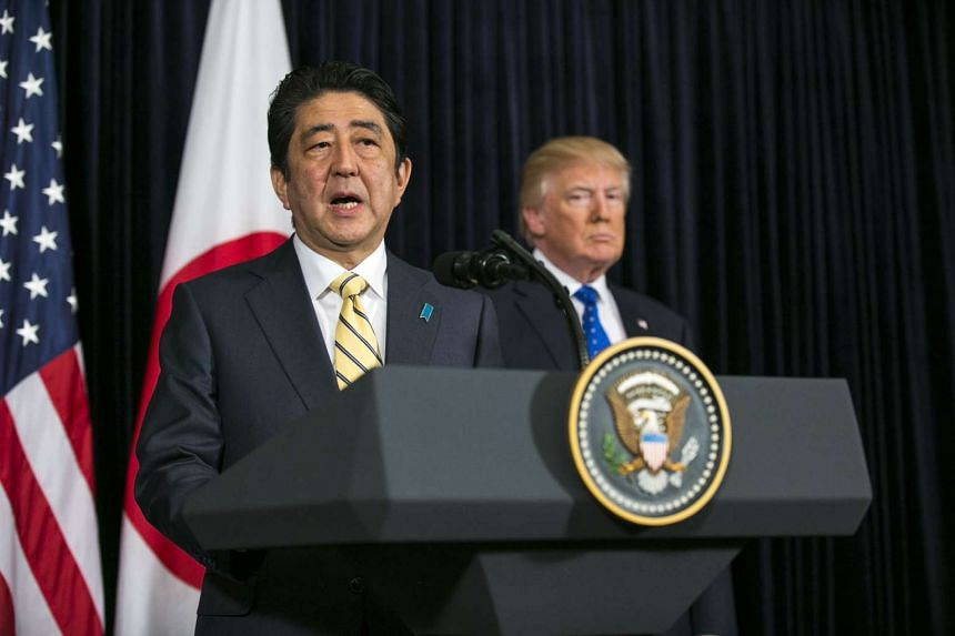 Japan's PM Shinzo Abe and US President Donald Trump, at a news conference to address a missile North Korea launched toward the sea off its eastern coast, at the Mar-a-Lago resort, on Feb 11, 2017.