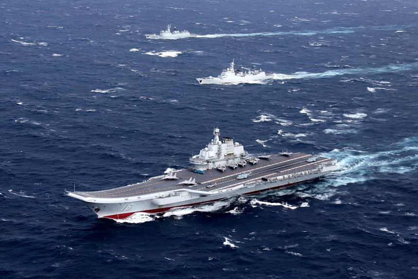 China's Liaoning aircraft carrier with accompanying fleet conducts a drill in an area of South China Sea, in this undated photo taken in December 2016.