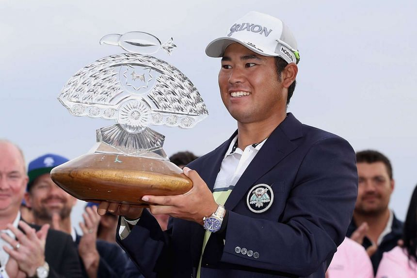 Hideki Matsuyama of Japan poses with the trophy after winning the Waste Management Phoenix Open on the fourth playoff hole at TPC Scottsdale on Feb 5, 2017.