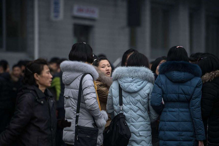 A group of women gathering on a street in Pyongyang, on Nov 27, 2016.