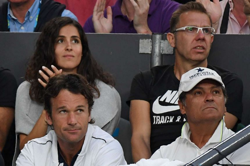 Toni Nadal (bottom right) watches Rafael Nadal in action at the Australian Open on Jan 27, 2017.