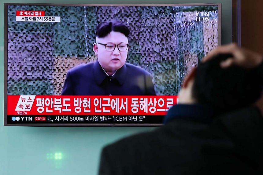 A man watches a news broadcast on North Korea's unidentified ballistic missile launch in Seoul, Feb 12, 2017.