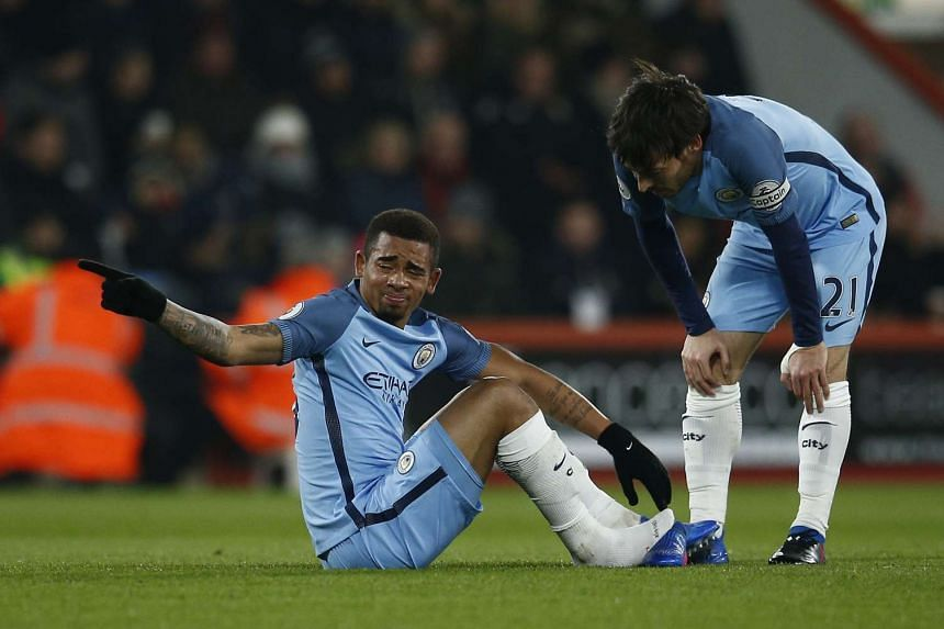 Manchester City's Gabriel Jesus sits after sustaining an injury as David Silva looks on, Feb 13, 2017.