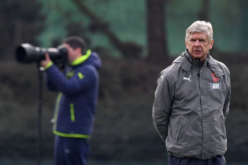 Wenger takes a training session on the eve of the match against Bayern Munich, Feb 14, 2017.