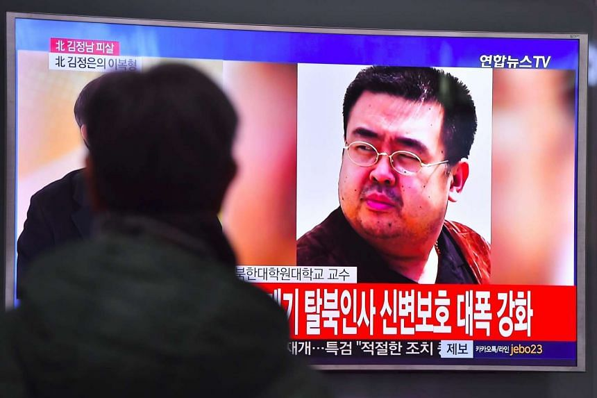 A man watches a television showing news reports of Kim Jong Nam, the half-brother of North Korean leader Kim Jong Un, in Seoul on Feb 14, 2017.