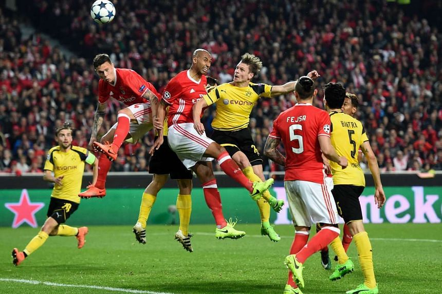 Borussia Dortmund's Polish defender Lukasz Piszczek (centre right) vying with Benfica's Brazilian defender Luisao (centre left) during the UEFA Champions League round of 16 first leg football match at the Luz stadium in Lisbon on Feb 14, 2017.