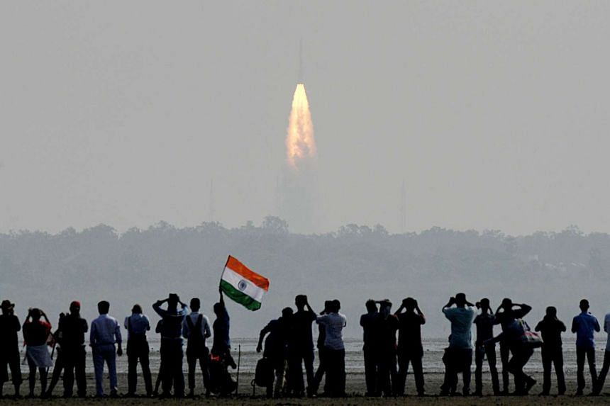 Onlookers watching the launch of the Indian Space Research Organisation (ISRO) Polar Satellite Launch Vehicle (PSLV-C37) at Sriharikota, on Feb 15, 2017.