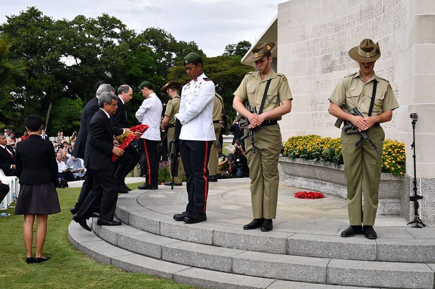 Officials and dignitaries lay a wreath of poppies near the Singapore Memorial to commemorate the 75th anniversary of the fall of Singapore on Feb 15, 2017.