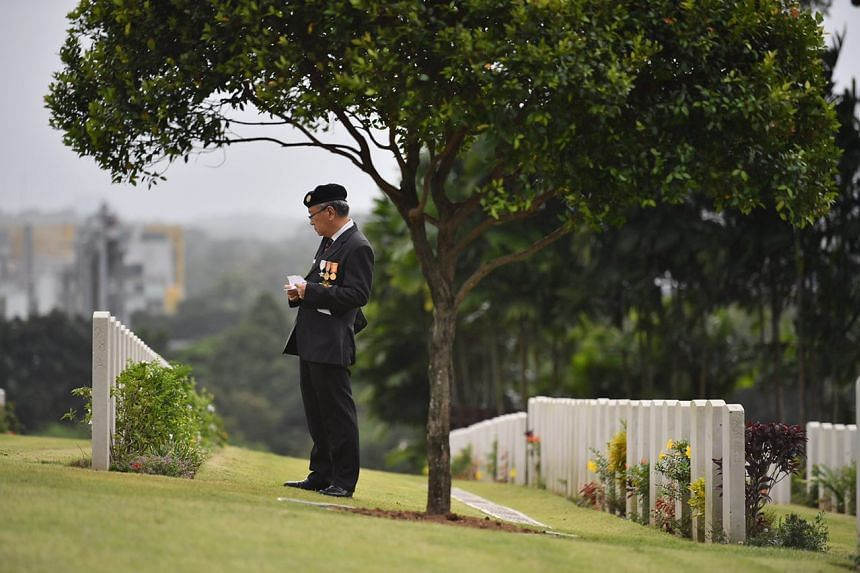 """Maj (Ret) Yap Siang Yong, 70, a member of Singapore Armed Forces Veterans' League, looking for tombstones of members of """"Z"""" Special Unit."""