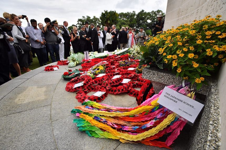 Wreaths are seen during a commemoration ceremony for the 75th anniversary of the fall of Singapore on Feb 15, 2017.